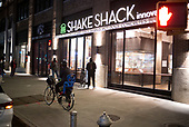 April 12, 2020<br /> New York, New York<br /> <br /> On the lower west side people wait to pick up food they ordered at a Shake Shake social distancing the height of the coronavirus pandemic. More than 10,000 deaths reported throughout the state.