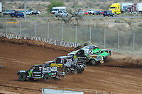 Mar. 19, 2011; Chandler, AZ, USA;  LOORRS pro lite driver Casey Currie in 2 tries to take two positions outside of Cameron Steele and Matt LoioDice during round one at Firebird International Raceway. Mandatory Credit: Mark J. Rebilas-US PRESSWIRE