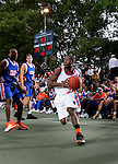 Erving Walker (15) drives to the basket during the Elite 24 Hoops Classic game on September 1, 2006 held at Rucker Park in New York, New York.  The game brought together the top 24 high school basketball players in the country regardless of class or sneaker affiliation.