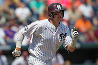 Mississippi State outfielder Hunter Renfroe (34) runs to first base during Game 11 of the 2013 Men's College World Series against the Oregon State Beavers on June 21, 2013 at TD Ameritrade Park in Omaha, Nebraska. The Bulldogs defeated the Beavers 4-1, to reach the CWS Final and eliminating Oregon State from the tournament. (Andrew Woolley/Four Seam Images)