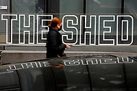 NEW YORK - NEW YORK - APRIL 02: A woman walks in front of The Shed sign at Hudson Yards on April 02, 2021 in New York. New York takes another step forward to reopening arts and entertainment, venues are allowed to welcome back people with the guidelines say indoor spaces can have up to 100 audience members and outdoor venues can have 200. (Photo by John Smith/VIEWpress)