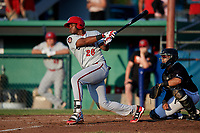 Auburn Doubledays first baseman Jamori Blash (26) follows through on a swing in front of catcher Igor Baez (29) during a game against the Batavia Muckdogs on June 28, 2018 at Dwyer Stadium in Batavia, New York.  Auburn defeated Batavia 14-9.  (Mike Janes/Four Seam Images)