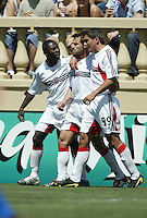 DC United's Freddie Adu and Jamie Moreno celebrate Dema Kovalenko's (center) tying goal during an MLS match agasinst the San Jose Earthquakes and DC United on May 1, 2004 at Spartan Stadium in San Jose, California.