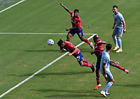 KANSAS CITY, KS - SEPTEMBER 19: Franco Jara #29 of FC Dallas heads the ball for the opening goal as Luis Martins #36 and Roberto Puncec #4 of Sporting Kansas City look on during a game between FC Dallas and Sporting Kansas City at Children's Mercy Park on September 19, 2020 in Kansas City, Kansas.