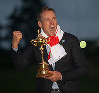 28.09.2014. Gleneagles, Auchterarder, Perthshire, Scotland. The Ryder Cup, final day.  Ian Poulter (EUR) celebrates with the Ryder Cup after Sunday Singles.  Europe won sixteen and a half points to eleven and a half points.