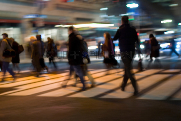 Commuters Crossing 42nd Street and Heading Home During the Evening Rush Hour in Midtown Manhattan, New York City, New York State, USA<br /> <br /> AVAILABLE FOR COMMERCIAL 0R EDITORIAL LICENSING FROM GETTY IMAGES.  Please go to www.gettyimages.com and search for image # 144516864.