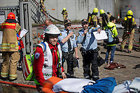 "Emergency personell responds to a ""fire"" . HarbourEx15, a field training exercise with scenarios connected to operations in the harbor April 27th – 29th 2015.<br />