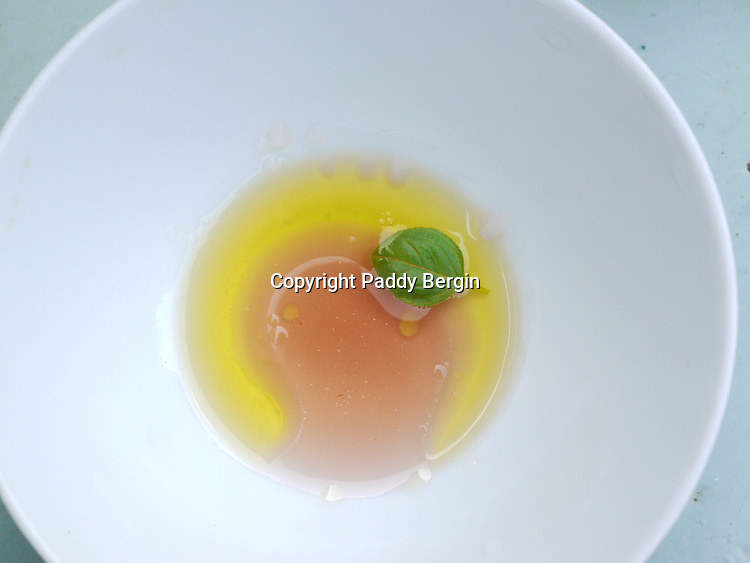 A very basic dressing made with Safra Grape Juice, some oil, squeezed lemon juice, a bit of sugar, maybe some mashed garlic and pepper. Finally a Basil leaf and what I really like is the different colours remain seperate until mixed.<br />