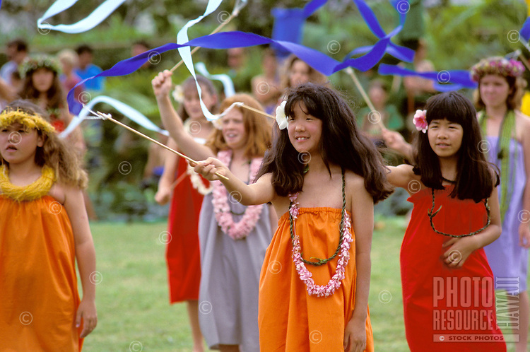 Girls in colorful aloha wear dance in the 6th grade program at the May Day/Lei Day celebration at Aikahi Elementary School in Kaneohe on Oahu's windward side.