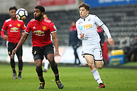 Sunday 18 March 2018<br /> Pictured:  Daniel James of Swansea City is marked by Ro Shaun Williams of Manchester United<br /> Re: Swansea City v Manchester United U23s in the Premier League 2 at The Liberty Stadium on March 18, 2018 in Swansea, Wales.