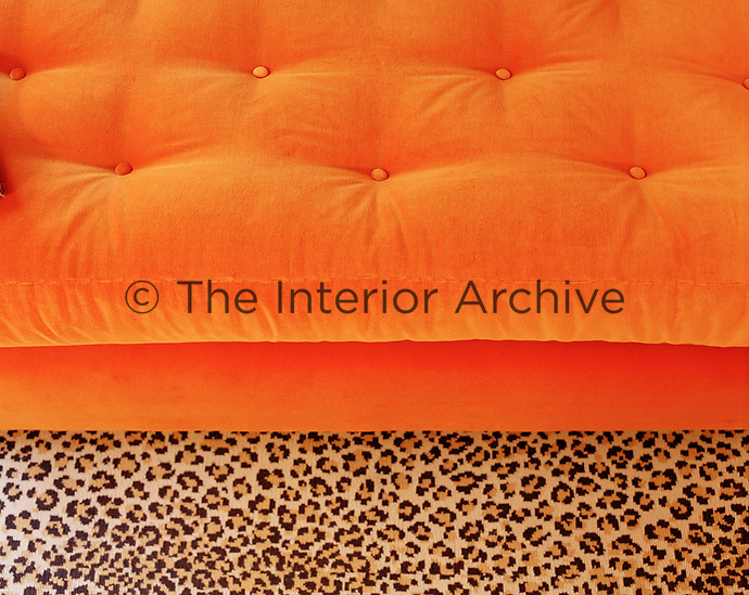 Glimpses of a plush bright orange velvet Chesterfield daybed zing alongside a daring leopard print carpet in the home of the incomparable former House & Garden Editor-in-Chief, Mary Jane Pool.