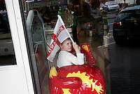 A boy waves an English flag as Prime Minister and Labour Party leader Gordon Brown arrives to campaign at an Asda supermarket in Weymouth.