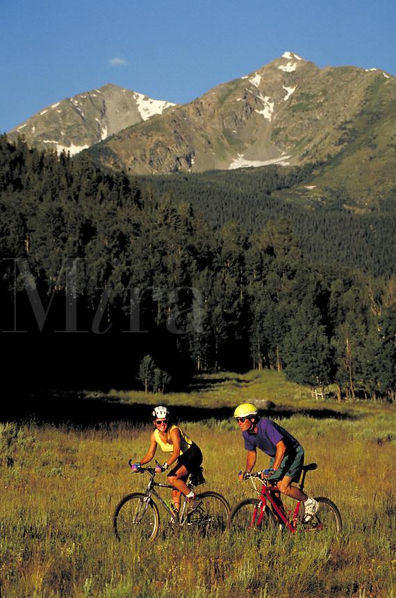 Steve Holmes (MR496) & Holly Issacson (MR431) mountain biking, Peak One, Summit County, CO. Steve Holmes (MR496) & Holly Issacson (MR431). Summit County, Colorado.
