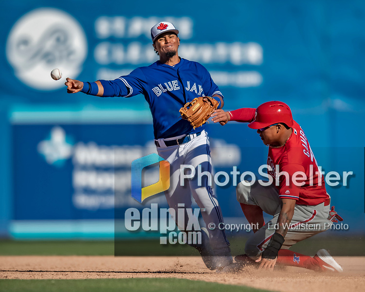 6 March 2019: Toronto Blue Jays infielder Santiago Espinal rmakes attempts to complete a double-play during a Spring Training game against the Philadelphia Phillies at Dunedin Stadium in Dunedin, Florida. The Blue Jays defeated the Phillies 9-7 in Grapefruit League play. Mandatory Credit: Ed Wolfstein Photo *** RAW (NEF) Image File Available ***