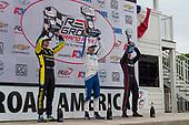 Second Place #26: Colton Herta, Andretti Autosport Honda (L), Race Winner #10: Alex Palou, Chip Ganassi Racing Honda (C), and Third Place #12: Will Power, Team Penske Chevrolet (R)