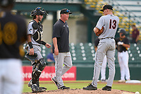 Jupiter Hammerheads pitching coach Jason Erickson (29) during a mound visit with pitcher Chris Mokma (13) and catcher Cameron Barstad (17) during a game against the Bradenton Marauders on June 23, 2021 at LECOM Park in Bradenton, Florida.  (Mike Janes/Four Seam Images)