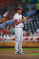 Frisco RoughRiders pitcher David Martinez (36) gets ready to deliver a pitch during a game against the Springfield Cardinals  on June 4, 2015 at Hammons Field in Springfield, Missouri.  Frisco defeated Springfield 8-7.  (Mike Janes/Four Seam Images)