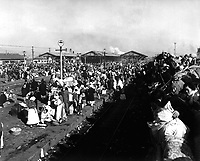 Refugees crowd railway depot at Inchon, Korea, in hopes they may be next to get aboard for trip further south and safety from communist hordes.  January 3, 1951.  C.K. Rose. (Navy)<br /> NARA FILE #:  080-G-425418<br /> WAR & CONFLICT BOOK #:  1476