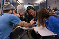 Left to right: Trevor Sporer, Katie Radford, Tierra Nettles, and Meghan Duryea work together on a group assignment exploring the math behind radial engines during Dr. Mark Fitch's Art of Math course (MATH A115) in UAA's Social Sciences Building.