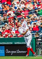 30 April 2017: Washington Nationals first baseman Ryan Zimmerman pulls in an infield pop-up in the 7th inning against the New York Mets at Nationals Park in Washington, DC. The Nationals defeated the Mets 23-5, with the Nationals setting several individual and team records, in the third game of their weekend series. Mandatory Credit: Ed Wolfstein Photo *** RAW (NEF) Image File Available ***