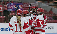 Boston, Massachusetts - December 1, 2018: NCAA Division I. Boston University (white) defeated Boston College (maroon), 4-2, at Walter Brown Arena.<br /> Abby Cook celebrates her goal with teammates.