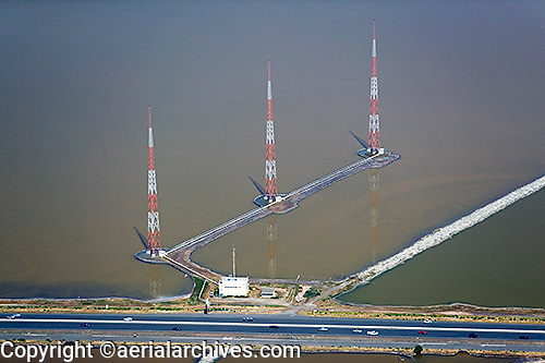 aerial photograph three radio transmission towers near San Francisco Oakland Bay Bridge toll plaza, Oakland, California