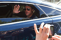 Cardonald - Glasgow, Scotland. Brad Pitt waves to fans as he leaves the super market set in Cardonald as filming ends for the day of World War Z in Glasgow..Picture: Maurice McDonald/Universal News And Sport (Scotland). 20 August 2011. www.unpixs.com..
