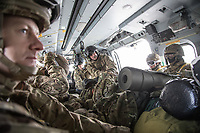 A British Merlin helicopter filled with troops during practice in the Arctic, near Bardufoss, Norway. <br /> <br /> In 2019 the Arctic exercise Clockwork passed 50 years of training in Norway, and now has a permanent base within the Norwegian Air Force base at Bardufoss. <br /> <br /> 845 Naval Air Squadron is a squadron of the Royal Navy's Fleet Air Arm. Part of the Commando Helicopter Force, it is a specialist amphibious unit operating the Leonardo Commando Merlin Mk3 helicopter and provides troop transport and load lifting support to 3 Commando Brigade Royal Marines.<br /> <br /> ©Fredrik Naumann/Felix Features