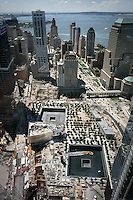 Tenth anniversary of 9/11.  Rebuilding at the World Trade Center site.  Footprints of the North Tower, foreground, and South Tower, background, of the World Trade Center, will have cascading water and are part of the underconstruction 9/11 Memorial.  Photo by Ari Mintz.  8/11/2011.