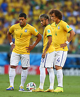 Hulk, Neymar and David Luiz of Brazil stand over a free kick