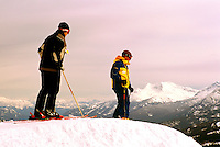 Two Friends downhill skiing on Whistler Mountain at Whistler Resort, in the Coast Mountains, Whistler, British Columbia, Canada