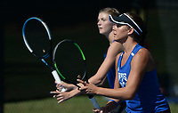 Rogers' Grace Lueders (right) and doubles partner JK Bohnert prepare to return a shot Tuesday, Oct. 12, 2021, as they compete in the 6A state tennis finals at Memorial Park in Bentonville. Visit nwaonline.com/211013Daily/ for today's photo gallery.<br /> (NWA Democrat-Gazette/Andy Shupe)
