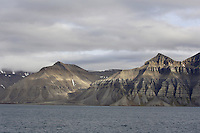 Sun lighting up mountain landscape near Longyearbyen on Spitzbergen Arctic Norway