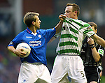 Neil McCann lifts Joos Valgaeren off the deck by his shirt during the Rangers v Celtic match at Ibrox in December 2002.