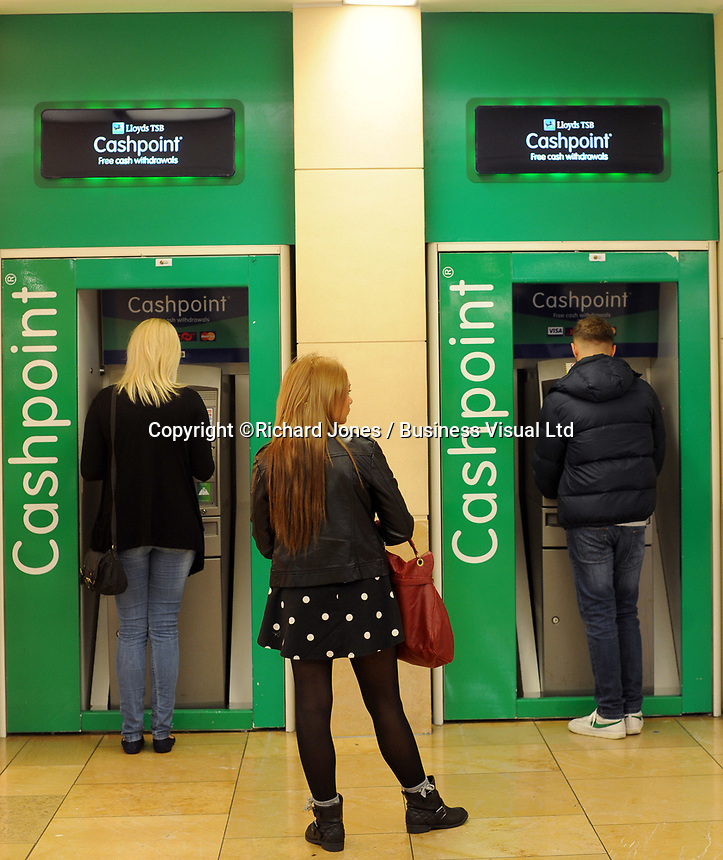 Lloyds Bank customers withdraw cash in Cardiff.      29-Sept-2013