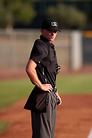 Home plate umpire Bailey Dutten between innings of an Arizona League game between the AZL Giants Black and the AZL Giants Orange on July 19, 2019 at the Giants Baseball Complex in Scottsdale, Arizona. The AZL Giants Black defeated the AZL Giants Orange 8-5. (Zachary Lucy/Four Seam Images)