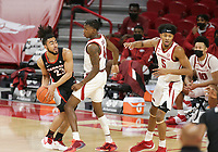 Georgia Mikal Starks (23) looks for an opening as Arkansas guard Davonte Davis (4) blocks, Saturday, January 9, 2021 during the first half of a basketball game at Bud Walton Arena in Fayetteville. Check out nwaonline.com/210110Daily/ for today's photo gallery. <br /> (NWA Democrat-Gazette/Charlie Kaijo)