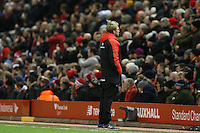 Liverpool Manager Jurgen Klopp turns his back towards the match as James Milner takes a penalty during the Barclays Premier League Match between Liverpool and Swansea City played at Anfield, Liverpool on 29th November 2015