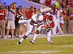 Oklahoma Sooners running back Brandon Williams (23) and Ball State Cardinals cornerback Eric Patterson (36) in action during the game between the Ball State Cardinals  and the Oklahoma Sooners at the Oklahoma Memorial Stadium in Norman, Oklahoma. OU defeats Ball State 62 to 6.