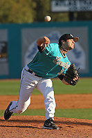 Anthony Meo #13 of the Coastal Carolina University Chanticleers pitching in a game against the University of Michigan Wolverines at the Carvelle Resort Classic Tournament held at Watson Stadium at Vrooman Field in Conway,, SC on March 13, 2010. Photo by Robert Gurganus/Four Seam Images