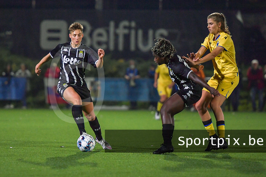 Kristina Erman (4) of Sporting du Pays de Charleroi , Manyima Stevelmans (34) of Sporting du Pays de Charleroi and Marie Minnaert (13) of Club Brugge pictured during a female soccer game between Sporting Charleroi and Club Brugge YLA on the sixth matchday in the 2021 - 2022 season of Belgian Scooore Womens Super League , friday 8 October 2021 in Marcinelle , Belgium . PHOTO SPORTPIX | STIJN AUDOOREN