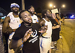 BATON ROUGE, LA -JULY 09: Protesters lock arms and shout at law enforcement in riot gear on July 9, 2016 in Baton Rouge, Louisiana. Alton Sterling was shot by a police officer in front of the Triple S Food Mart in Baton Rouge on July 5th, leading the Department of Justice to open a civil rights investigation. (Photo by Mark Wallheiser/Getty Images)
