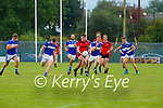 Tom Murnane Kenmare makes a burst with Templenoe's Gavin Crowley Sean Sheehan and Dan Cahalane in hot pursuit contest the kick out during their game in Killarney on Sunday