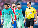 Lionel Andres Messi (2nd r) of FC Barcelona talks to the referee Antonio Mateu Lahoz (r) during their La Liga match between Atletico de Madrid and FC Barcelona at the Santiago Bernabeu Stadium on 26 February 2017 in Madrid, Spain. Photo by Diego Gonzalez Souto / Power Sport Images