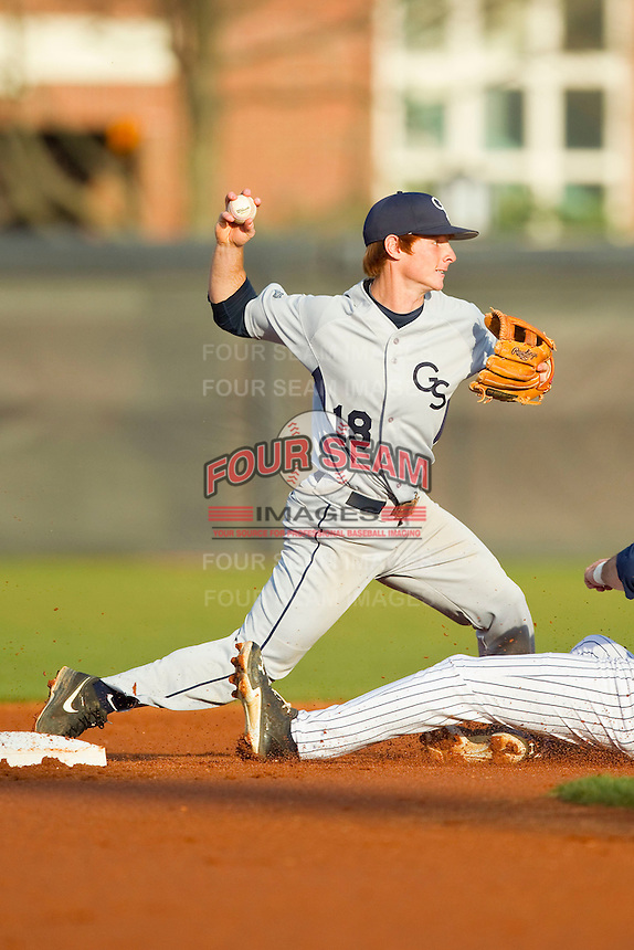 Georgia Southern Eagles shortstop Ben Morgan (18) turns a double play against the UNCG Spartans at UNCG Baseball Stadium on March 29, 2013 in Greensboro, North Carolina.  The Spartans defeated the Eagles 5-4.  (Brian Westerholt/Four Seam Images)
