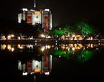 Hanoi People's Committee Building At Night - The Hanoi People's Committee building reflected in Hoan Kiem Lake at night, Hanoi, Vietnam