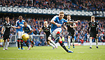 Martyn Waghorn takes his penalty kick but it is saved by the keeper