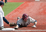 March 24, 2012:   Loyola Marymount's Matt Lowenstein is picked off diving into first as Nevada first baseman Kewby Meyer applies the tag during their NCAA baseball game played at Peccole Park on Saturday afternoon in Reno, Nevada.