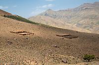 Atlas Mountains, near Tizi N'Tichka Pass, Morocco.  House and Livestock Pen on Hillside.