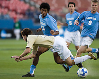 North Carolina midfielder Ryan Adeleye (13) trips up Wake Forest forward Cody Arnoux (17).  North Carolina Tar Heels defeated Wake Forest Demon Deacons 1-0 in the semifinal match of the NCAA Men's College Cup at Pizza Hut Park in Frisco, TX on December 12, 2008.  Photo by Wendy Larsen/isiphotos.com